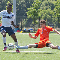 Brampton's Lee Victor Massunda (in white) watches as  North York's Morgan Walker goes for the ball in U17 Ontario Cup preliminary action at Creditview Sandalwood on Saturday. Brampton won the game 3-0.
