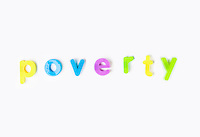 Poverty' spelled with colorful alphabet magnets over white background