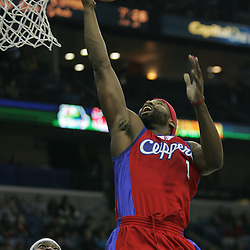 Jan 13, 2010; New Orleans, LA, USA; Los Angeles Clippers guard Baron Davis (1) shoots over New Orleans Hornets guard Devin Brown (23) during the first quarter at the New Orleans Arena. Mandatory Credit: Derick E. Hingle-US PRESSWIRE