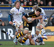 Wycombe, GREAT BRITAIN,  Wasps, Daniel LEO, tackled by right. James SCAYSBROOK and low Danny GREWCOCK, during the Guinness Premiership game London Wasps v Bath Rugby, at Adams Park, Bucks  29/12/2007 [Mandatory Credit Peter Spurrier/Intersport Images]