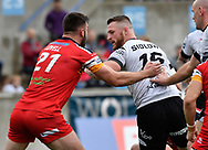 Adam Sidlow (R) of Toronto Wolfpack  hands off the tackle of Will Lovell (L) of London Broncos during the Super 8s Qualifiers Million Pound Game at Lamport Stadium, Toronto, Canada<br /> Picture by Stephen Gaunt/Focus Images Ltd +447904 833202<br /> 07/10/2018