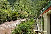 Inka Rail train along Vilcanota River from village of Ollantaytambo to Machu Picchu Pueblo, Peru.