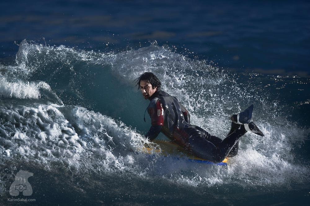 Bodyboarder at Lyall bay, Wellington, New Zealand.