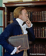 Thomas Jefferson searches for a book in the study of the George Wythe House. 18th Century scene at historic Colonial Williamsburg, Williamsburg, Virginia. Photo by David M. Doody