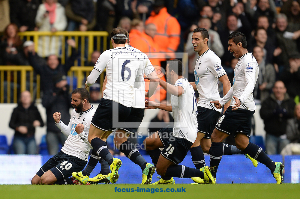Picture by Andrew Timms/Focus Images Ltd +44 7917 236526<br /> 01/12/2013<br /> Sandro of Tottenham Hotspur celebrates scoring their second goal with team mates during the Barclays Premier League match against Manchester United at White Hart Lane, London.