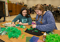 "Amelia Cluett and Kyra Bryant work on a feather head dress during ""Tech Day"" for Once Upon A Mattress at Belmont High School on Saturday.  (Karen Bobotas/for the Laconia Daily Sun)"