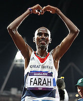 Mohamed Farah of Great Britain celebrates after the 10000m final during track and field at the Olympic Stadium during day 8 of the London Olympic Games in London, England, United Kingdom on August 3, 2012..(Jed Jacobsohn/for The New York Times)..