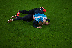 CARDIFF, WALES - Sunday, October 13, 2019: A pitch invader is tackled to the ground by a response steward during the UEFA Euro 2020 Qualifying Group E match between Wales and Croatia at the Cardiff City Stadium. (Pic by Paul Greenwood/Propaganda)
