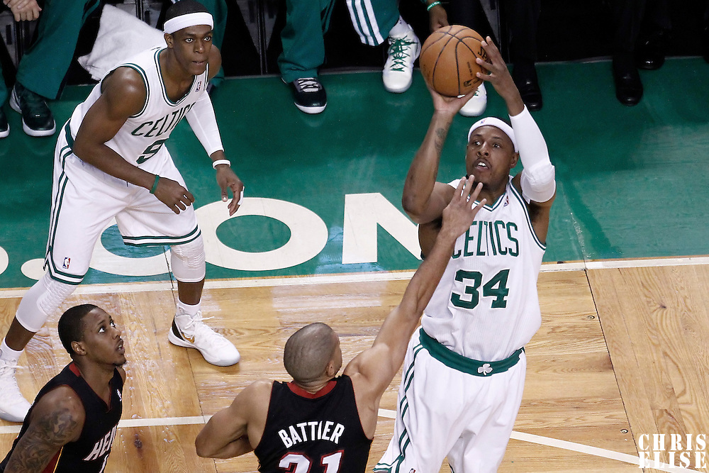 03 June 2012: Boston Celtics small forward Paul Pierce (34) takes a jumpshot over Miami Heat small forward Shane Battier (31) during the first quarter of Game 4 of the Eastern Conference Finals playoff series, Heat at Celtics, at the TD Banknorth Garden, Boston, Massachusetts, USA.