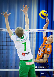 Ivan Colovic of Panvita Pomgrad vs Matija Plesko of ACH during volleyball game between OK ACH Volley and OK Panvita Pomgrad in 1st final match of Slovenian National Championship 2013/14, on April 6, 2014 in Arena Tivoli, Ljubljana, Slovenia. Photo by Vid Ponikvar / Sportida