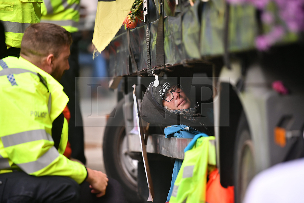 © Licensed to London News Pictures. 08/10/2019. London, UK. Extinction Rebellion activists demonstrate at Department for Environment, Food and Rural Affairs in Westminster. Activists have converged on Westminster for a second day, blockading roads in the area and calling on government departments to 'Tell the Truth' about what they are doing to tackle the Emergency. Photo credit: Ben Cawthra/LNP