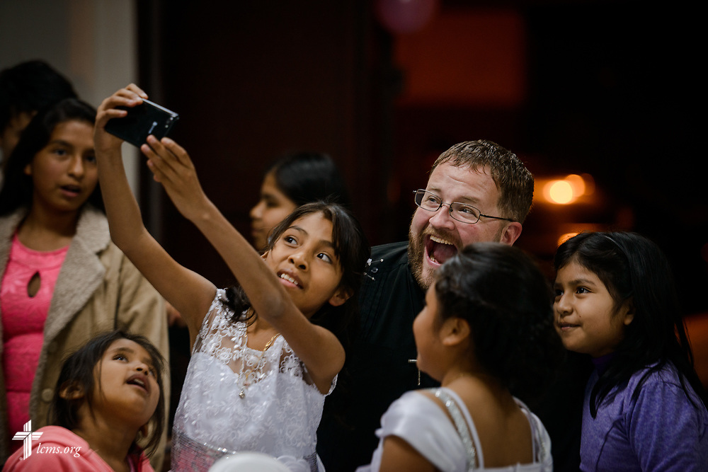 The Rev. Eddie Hosch, LCMS career missionary to Peru, poses for a selfie photograph with new confirmands and their friends at Castillo Fuerte on Saturday, Nov. 4, 2017, in the La Victoria district of Lima, Peru. LCMS Communications/Erik M. Lunsford