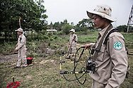 With the help of the RENEW project (Restoring the Environment and Neutralizing the Effects of the War) and Norwegian People's Aid, a bomb-disposal team uses mine detection equipment to clear mines in Quang Tri Province, Vietnam, Southeast Asia
