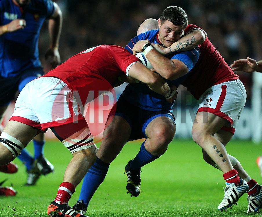 Evan Olmstead of Canada and Ray Barkwill of Canada tackle Benjamin Kayser of France  - Mandatory byline: Joe Meredith/JMP - 07966386802 - 01/10/2015 - Rugby Union, World Cup - Stadium:MK -Milton Keynes,England - France v Canada - Rugby World Cup 2015