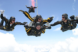 Former United States President George H.W. Bush jumps with the United States Army Golden Knights Parachute Team at the Bush Presidential Library near Houston, Texas on June 13, 2004 to celebrate his his 80th birthday. His jump was witnessed by 4,000 people including Actor and martial-arts expert Chuck Norris and Fox News Washington commentator Brit Hume. Both also participated in celebrity tandem jumps as part of the event. Bush made the jump harnessed to Staff Sergeant Bryan Schell of the Golden Knights. Bush was reportedly contemplating a free-fall jump, but officials said the wind conditions and low cloud cover made it too risky. Former Soviet President Mikhail Gorbachev was also on site. He was reportedly invited by Bush to join the jump, but said he had never parachuted and was too old to start. This was Bush?s fifth jump. He also jumped with the Golden Knights on his 75th birthday. He said that he wanted to send a message to seniors that they ?still have a life.?<br /> Photo by US Army via CNP/ABACAPRESS.COM