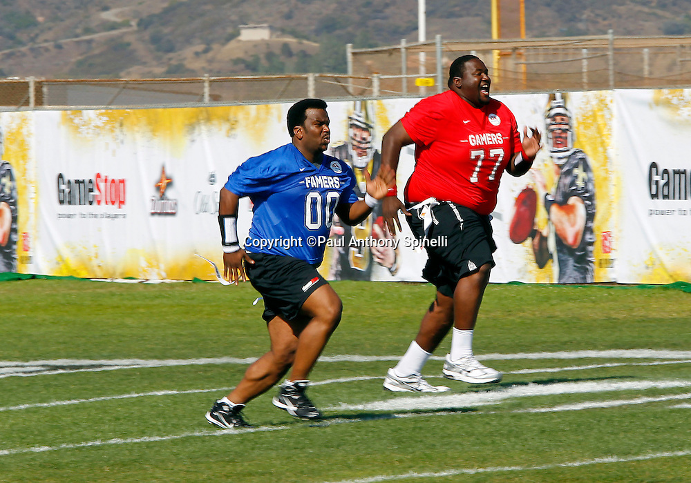 Actor Quinton Aaron (77) who played Baltimore Ravens offensive tackle Michael Oher in the 2009 movie The Blind Side races against actor Craig Robinson (00) while playing flag football in the EA Sports Madden NFL 11 Launch celebrity and NFL player flag football game held at Malibu Bluffs State Park on July 22, 2010 in Malibu, California. (©Paul Anthony Spinelli)