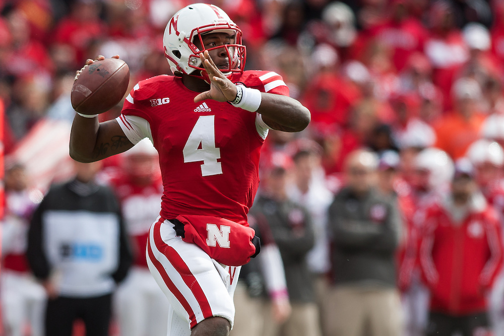 October 5, 2013: Quarterback Tommy Armstrong Jr. (4) of the Nebraska Cornhuskers looking to to pass against the Illinois Fighting Illini at Memorial Stadium in Lincoln, Nebraska. Nebraska defeated Illinois 39 to 19.