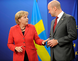 Angela Merkel, Germany's chancellor, left, speaks with Fredrik Reinfeldt, Sweden's prime minister, as she arrives for the European Summit at the EU headquarters in Brussels, Belgium, on Thursday, Sept. 17, 2009. European Union leaders may call for sanctions on banks that pay excessive bonuses, fearing that runaway executive pay could trigger another financial crisis, a draft text showed. (Photo © Jock Fistick) *** Local Caption *** Angela Merkel.