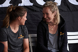 Amy Pieters (NED) and Karol-Ann Canuel (CAN) share a joke at Giro Rosa 2018 - Team Presentation in Verbania, Italy on July 5, 2018. Photo by Sean Robinson/velofocus.com