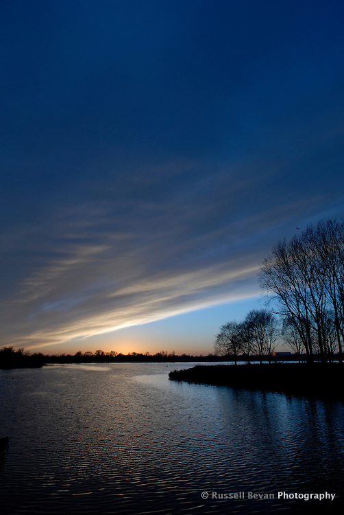 Sunset over a lake in the Cotswold Water Park