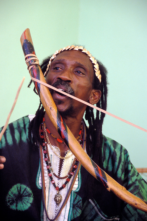 Russell Soleano, musician with band Issoco, playing a traditional instrument called the Benta at Villa Maria art gallery & museum reception; Willemstad, Curacao, Netherlands Antilles.