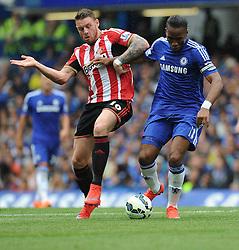 Chelsea's Didier Drogba battles for the ball with Sunderland's Connor Wickham - Photo mandatory by-line: Alex James/JMP - Mobile: 07966 386802 - 24/05/2015 - SPORT - Football - London - Stamford Bridge - Chelsea v Sunderland - Barclays Premier League