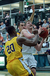 21 February 2017: Andy Stempel gets doubled under the basket by Brett Benning and Chrishawn Orange during an College men's division 3 CCIW basketball game between the Augustana Vikings and the Illinois Wesleyan Titans in Shirk Center, Bloomington IL