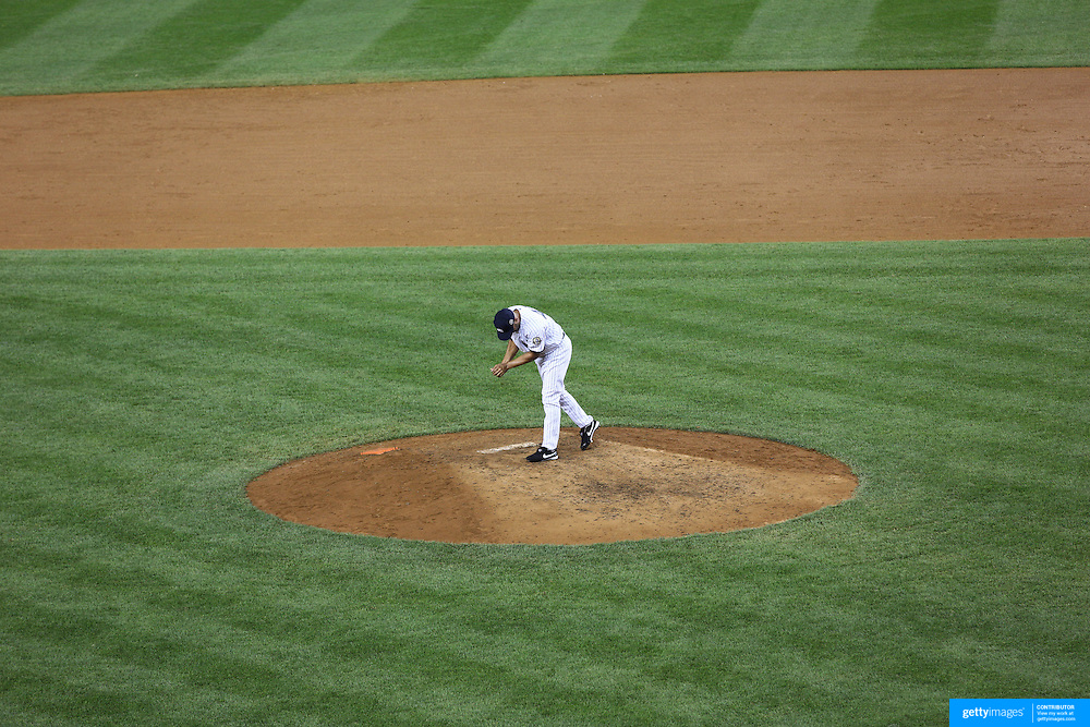 Mariano Rivera, the New York Yankees pitcher, collects some dirt from the mound after his last game at Yankee Stadium before his retirement during the New York Yankees V Tampa Bay Rays, American League baseball game at Yankee Stadium. Mariano Rivera is the last Major League player still wearing Jackie Robinson's No. 42. and holds the record for the number of saves in Major League Baseball. Yankee Stadium, The Bronx, New York USA. 26th September 2013. Photo Tim Clayton