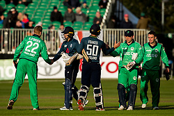 Ireland's Kevin O'Brien congratulates England's Tom Curran as England's Ben Foakes commiserates Ireland's wicket keeper Gary Wilson and Andrew McBrine after the One Day International match at Malahide Cricket Club, Dublin.