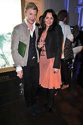 MARTINE McCUTCHEON and HENRY CONWAY at a photographic retrospective showcasing images from Guess's historic advertising campaigns held at Il Bottaccio, Grosvenor Place, London on 28th October 2009.