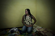 Rosa poses for photographs in a room in a lodge provided by Ludruk Karya Budaya owner for the transvestites player in Mojokerto, East Java, Indonesia, June 9, 2015. Rosa owns a salon in her hometown.