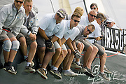 The crew of Magic Glove, IRC Class 0, hang over the weeather rail on day one of Skandia Cowes Week 2006