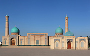 """Khast Imam Square, with Tellya Sheikh Mosque, founded 16th century, restored 19th century, Tashkent, Uzbekistan, pictured on July 4, 2010, in the afternoon. Tashkent's main Friday mosque holds the Osman Koran, claimed to be the world's oldest, in its library. Tashkent, 2000 year old capital city of Uzbekistan, a Silk Road city whose name means """"Stone Fortress"""", is now very modern due to a disastrous earthquake in 1966, after which it was greatly rebuilt. However, some of the old buildings still stand in the glittering modern city. Picture by Manuel Cohen."""