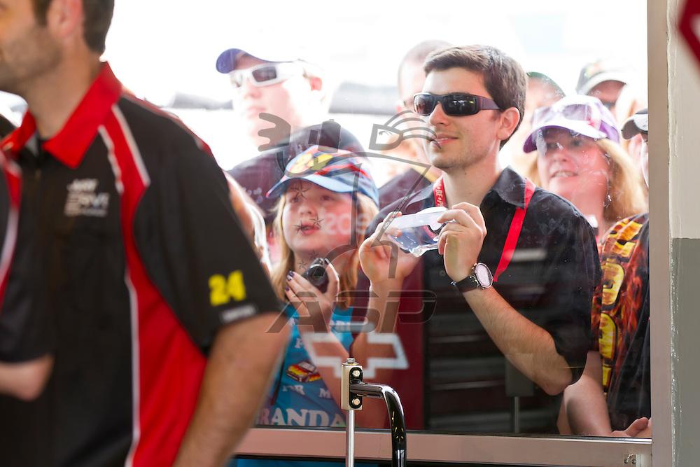 Daytona Beach, FL - Feb 18, 2012:  Jeff Gordon (24) talks to his crew before a practice session for the Daytona 500 at the Daytona International Speedway in Daytona Beach, FL.