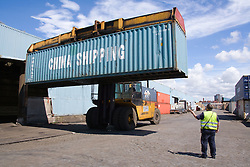 Shipping container being moved at Seaforth Container depot terminal Liverpool Docks; England,