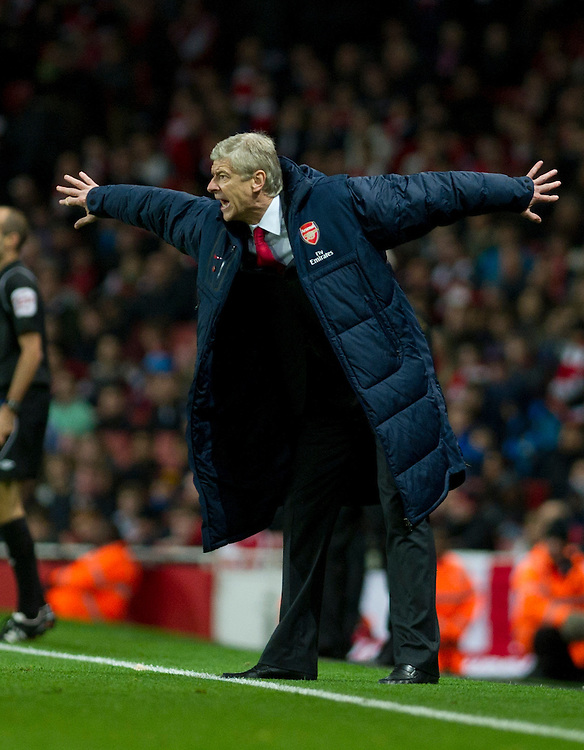 Arsenal's manager Arsene Wenger reacts during their English Premier League soccer match against Fulham at the  Emirates stadium in London, Saturday, Nov. 26, 2011. (AP Photo/Bogdan Maran)