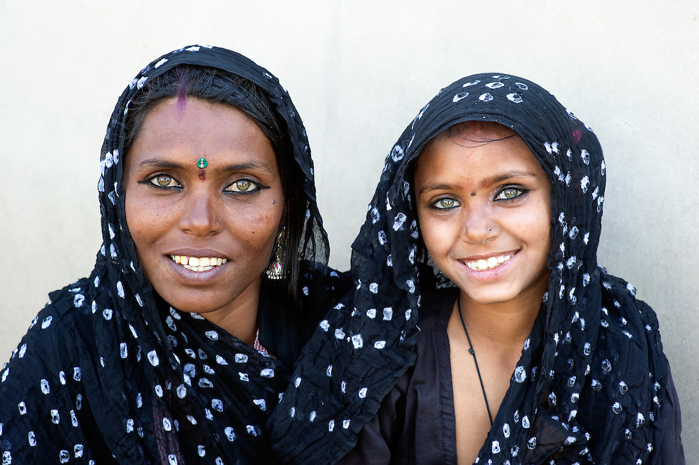 Rajasthani mother in Rajasthan, wearing the same traditional dress her duaghter wears.