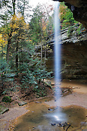 A Tall And Thin Waterfall At Ash Cave During Autumn In The Hocking Hills Region Of Central Ohio, USA