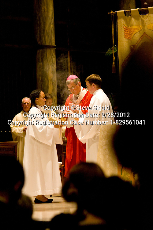 "Catholic priest preparing for the Eucharist. Basilica of ""St Mary"" St Paul Minnesota MN USA"