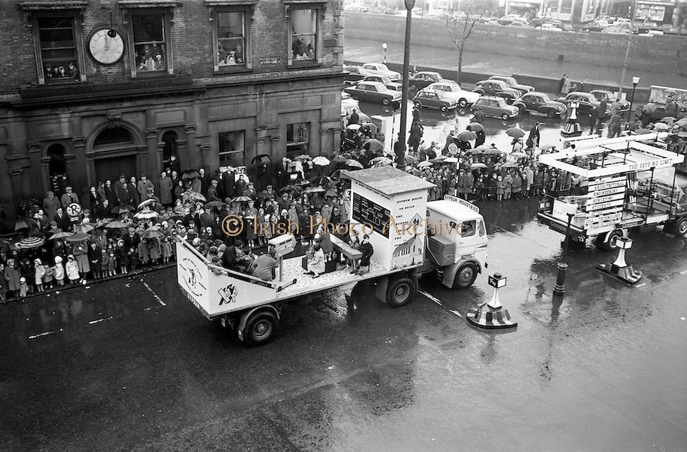 17/03/1963<br /> 03/17/1963<br /> 17 March 1963<br /> A  float promoting Gypsum Industries on a Leyland Beaver truck in the N.A.I.D.A. St. Patricks Day Parade, passes down  Westmoreland Street. Dublin.