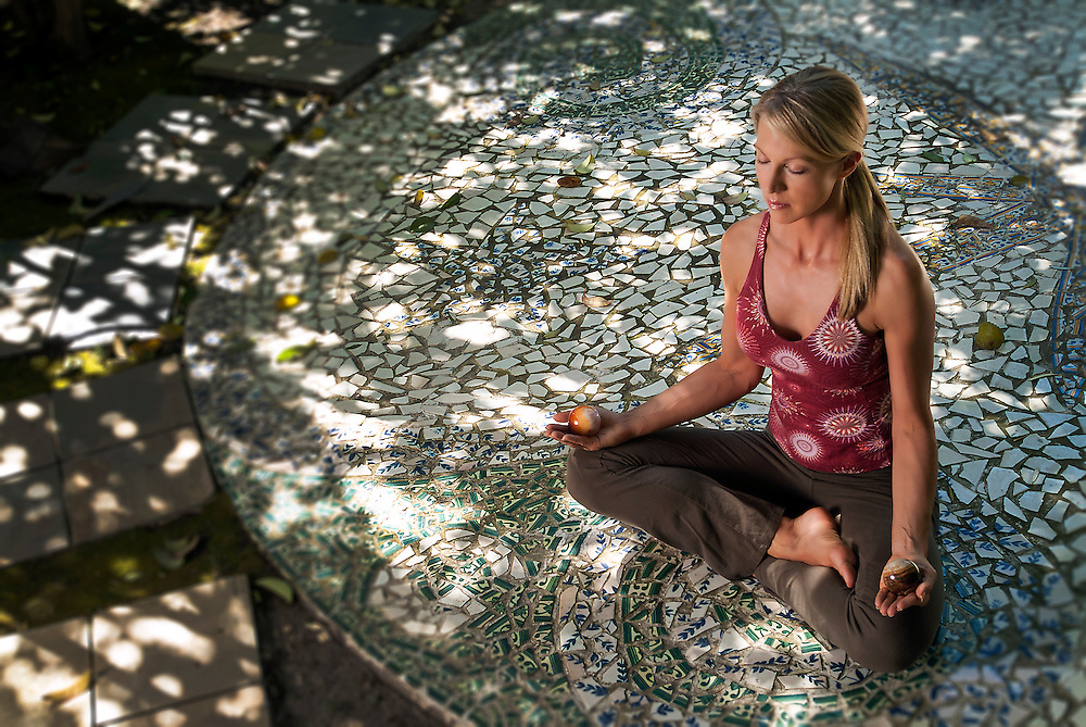 Young woman meditating in garden in Los Angeles, California, USA, North America.  Fitness Photographer Robert Randall