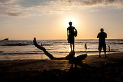 People are silhouetted on the beach in Nosara, Costa Rica.