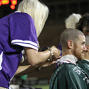 Mitch Belisle #85 of the Boston Cannons gets his head shaved following the game at Harvard Stadium on August 9, 2014 in Boston, Massachusetts. (Photo by Elan Kawesch)
