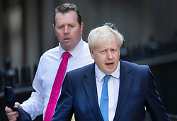 © Licensed to London News Pictures. 23/07/2019. London, UK. Mark Spencer MP (L) , new chief whip, walks with newly elected Conservative Party leader Boris Johnson at party headquarters after attending a reception. Photo credit: Peter Macdiarmid/LNP
