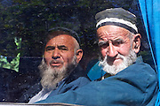 Uzbekistan, Bukhara. Old Uzbeks in traditional clothes in a bus.