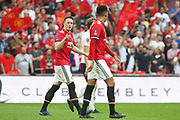 Manchester United Defender Phil Jones is angry and points the finger at Manchester United Defender Chris Smalling during the The FA Cup Semi Final match between Manchester United and Tottenham Hotspur at Wembley Stadium, London, England on 21 April 2018. Picture by Phil Duncan.