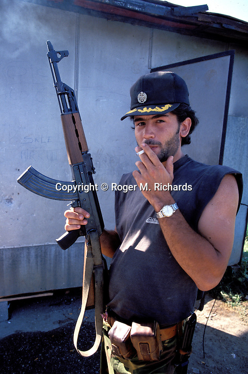 A Bosnian Serb gunman poses for a photograph at a checkpoint on the outskirts of Sarajevo through which journalists and United Nations personnel, both military and civilian, had to obtain permission from the Serbs to enter the besieged city, August 1992. (Photo by Roger Richards)