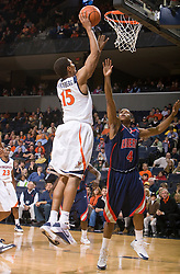 Virginia guard Sylven Landesberg (15) shoots over Liberty guard James Spencer (4). The Virginia Cavaliers fell to the Liberty Flames 86-82 in NCAA Division 1 men's basketball at the University of Virginia's John Paul Jones Arena  in Charlottesville, VA on March 9, 2008.