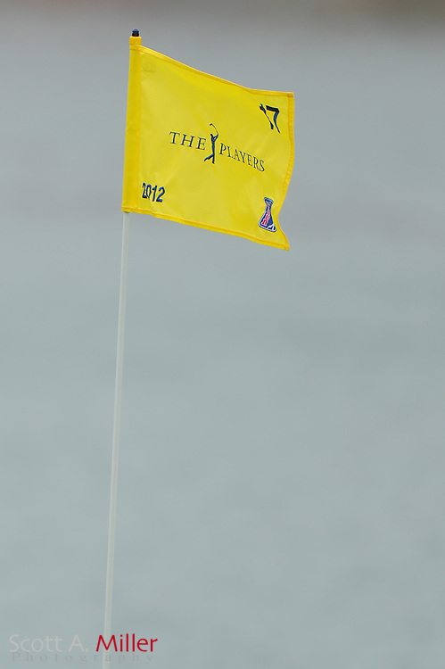 The pin flag on the 17th hole blows in thw ind during the final round of the Players Championship at the TPC Sawgrass on May 13, 2012 in Ponte Vedra, Fla. ..©2012 Scott A. Miller..