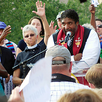 Reverend William Barber, center, speaks in Raleigh, North Carolina in 2013 at a Moral Monday Movement Rally.